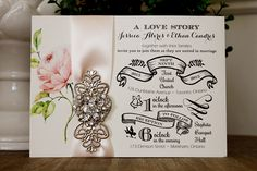 Vintage wedding invitation with heart broach and pale pink ribbon.  The invitation wording is printed on cream smooth paper.  www.stephita.com