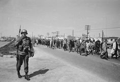 March 24, 1965: A military policeman with fixed bayonet keeps pace with the protesters in the Alabama civil rights march which was led by Dr Martin Luther King.