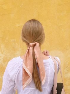 My favorite pink scarf is back in stock!!!!  Ponytail with a pretty pink scarf #SpringStyle #blonde #hairstyle