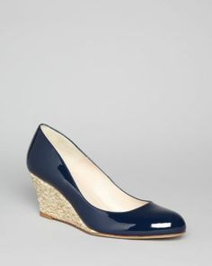 L.K. Bennett Wedge Pumps - Zella Round Toe Jute.      Fun wedge for smart day wear in summer - not too high heel. Navy suits most summer outfits.
