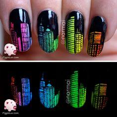 Glow in the dark city skyline nail art
