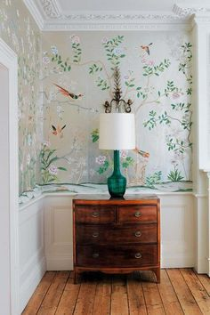 Beautiful and simple hallway vignette with stunning hand-painted Chinoiserie wallpaper behind.