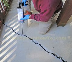 Concrete Slab Crack Repair photo tutorial. Apply Emecole 555 mixed with sand followed by finish grinding.