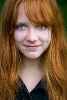 """Redhead with amazingly bright green eyes. Also a link attached for the ladies who would like """"special"""" make up tips for the green eyes displayed in the picture."""