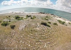 A labyrinth in the Baltic Sea near the historic fishing village at Sysne, Gotland, Sweden. Image by Lars Howlett