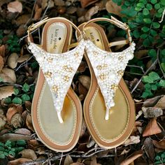 """Brides.com: Wedding Shoes for a Beach Wedding. Pearl-Embellished Kate Spade Sandals. What's more appropriate for an oceanside """"I Do"""" than pearl accessories? Forget the traditional strand, and try a festive pair of pearlized flats.   See more beach wedding accessories."""