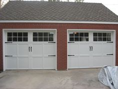 Picture 18: Wayne Dalton steel sectional garage door. Carriage house style with optional straps and handles. Color: white.