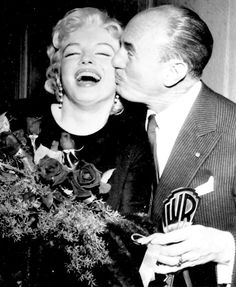 Marilyn and Jack L. Warner at a press conference for The Prince and The Showgirl in 1956.