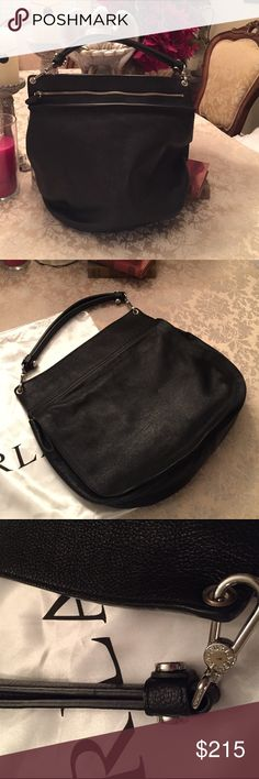 """Like new black pebble leather Furla bag Only used twice for only a few hours each time.  Just not my style but it is stunning--love the double arm strap with 5"""" drop, shiny silver tone hardware and overall sleek design. Exposed beige leather at top of interior and there is a big pocket and cell phone holder inside. Holds a ton of stuff--measures 15"""" x 16-1/2"""" when flat and there is a substantial 4"""" bottom. Original dust bag included, which is where it had been safely stored. A beautiful bag…"""