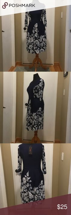 NWT Fit and Flare Dress Navy floral print fit and flare dress.NWT.  It even has pockets! Non-smoking home. Reborn Dresses Long Sleeve