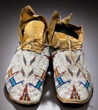 A PAIR OF CHEYENNE PICTORIAL BEADED HIDE MOCCASINS c. 1890