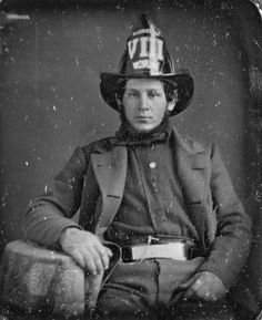 """Did a little looking and in the 1840s """"Manhattan VIII"""" was housed on Cedar St. near Nassau St. in Lower Manhattan. That would put it  close to where the 9/11 Memorial Museum is today. """"Manhattan VIII"""" was disbanded in 1865 when the old Volunteer Fire Dept. was done away with. In the days when this daguerreotype was taken firemen were pretty rough customers better with their fists than they were with hose and bucket. (I find it interesting that at the time a chief's salary was $1500 a year.)"""