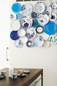 Plate gallery arrangement idea. I like them overlapping a little like that.