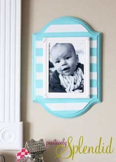 DIY Stacked Wall Frames - Pictures can easily be swapped out with the magic of Velcro!
