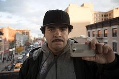 Jose LaSalle in East Harlem. He uses his phone to film what he says are unreasonable stops by police.
