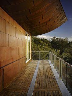 composite wood decking Deck Contemporary with balcony deck glass railing handrail overhang roofline rust steel