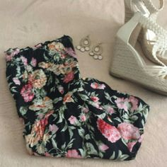 Floral Romper Such a cute floral romper! Rouched around the chest area to keep it in place along with elastic at the top. Has a pocket on each side. In good condition!   100% Rayon GOLD Drama Pants Jumpsuits & Rompers