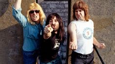 """Hello, Cleveland!""    English heavy metal band, Spinal Tap (L-R;  David St. Hubbins, Derek Smalls & Nigel Tufnel), 1984. (Photo by Pete Cronin/Redferns/Getty Images)"
