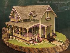 """Scale Dollhouses and Scenes from the Spring 2012 Seattle Show: Quarter scale """"Trinity Circle"""" dollhouse exhibited by Rosemary Shipman at the Spring 2012 Seattle Dollhouse Miniature Show. Kit by Debbie Young of Young at Heart Victorian Dollhouse, Modern Dollhouse, Diy Dollhouse, Dollhouse Furniture, Dollhouse Miniatures, Fairy Houses, Play Houses, Doll Houses, Miniature Rooms"""