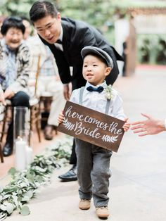 Adorable rustic ring bearer in a paper boy hat: http://www.stylemepretty.com/2016/09/17/all-white-franciscan-gardens-wedding/ Photography: Ether and Smith - http://etherandsmith.com/