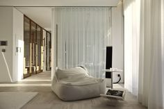 Modern and Contemporary Cosmopolitan House Design in Istanbul:Relaxed Seating Area Reading Nook Design And White Side Table Beside Comfort Gray Sofa