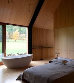 26 Awesome Baths In Modern Bedrooms: 26 Awesome Baths In Modern Bedrooms With White Bed And White Bathtub And Glass Door Design Dream Bedroom, Home Bedroom, Bedroom Decor, Bedroom Ideas, Attic Renovation, Attic Remodel, Contemporary Bedroom, Modern Bedroom, Bedroom With Bathtub