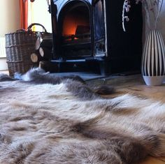 Cosy, snuggly and stylish, thick and luxurious reindeer skin from The Forest & Co. Ideal for draping over sofas or softening floorboards. An ideal Chalet Chic, Modern Rustic Homes, Fur Rug, Cabin Interiors, Brown And Grey, Dark Brown, Room Inspiration, Christmas Inspiration, Shag Rug
