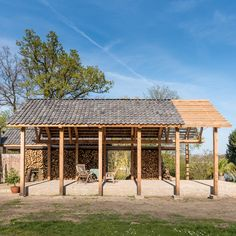 Timber pavilion by deBOSSA installed in the grounds of a Dutch mansion