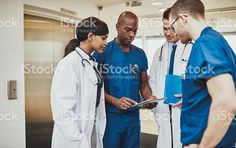 Black surgeon giving instruction to medical team royalty-free stock photo