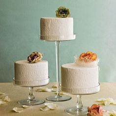 Simple White Wedding Cake Trio | Skip a single, tiered cake and, instead, place smaller ones at each table for guests to cut themselves.