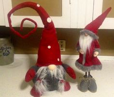 Red hat gnomes.  OH... wish the sitting gnome was for sale!  I'd buy it right away.  LOVE the braided beard!!