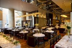 glass brasserie at the Hilton Sydney is set up for a lavish wedding reception