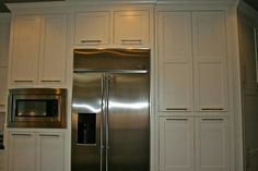 Custom Pantry With Built In Microwave And Antique Brushed