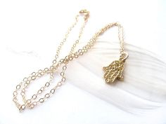 Gold Hamsa Necklace - Hamsa Necklace Dainty Hand Necklace - Good Luck Necklace by TheGoldBar.etsy.com  'Simple - Delicate - Small'  This gold hamsa necklace features a dainty hamsa hand charm suspended on delicate gold chain, so that your hamsa necklace is the perfect gold necklace to wear on it's own, and equally stunning with other gold layering necklaces.  A great gift for her birthday, anniversary or just because you love her. Perfect for a mom, wife, best friend or sister.