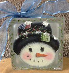Snowman on glass block                                                                                                                                                                                 More