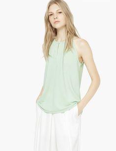 Green haltered neck shirt