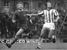 14th August 1971. Leicester City defender Alan Woolett attempts to Huddersfield Town centre forward Frank Worthington.