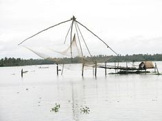 Chinese fishing net in the middle of backwaters     http://bamboonets.com/netting-techniques-2/