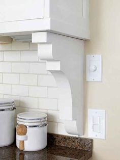 Transition your backsplash into the wall seamlessly with a shelf bracket. | 42 Ingeniously Easy Ways To Hide The Ugly Stuff In Your Home
