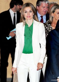 Princess Letizia modern classic fun yet conservative timeless style.  White suit with pop of color emerald green blouse - stunning