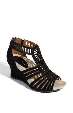 I usually go for no heel or super high heel but for some reason this works. tiny wedge works with the gladiator style...