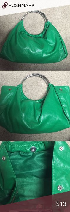 Green Clutch with silver hardware Very nice green clutch. Gently used and still can be worn on a casual or fancy nite!!! Bags Clutches & Wristlets