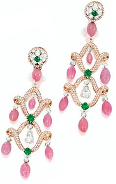 Conch pearl, diamond, pink diamond, and emerald earrings by Michael Youssoufian. Each suspending a fringe composed of seven drop-shaped conch pearls, centering on a briolette diamond, highlighted by step-cut emeralds and circular-cut diamonds and emeralds, supported by a frame set with pink diamonds, the pink diamonds, diamonds and emeralds weighing 2.15, 1.85 and 1.45 cts respectively, in 18 k pink and yellow gold. Via Sotheby's.