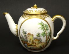 A Sevres Porcelain Teapot and Cover Decorated by Andre-Vincent Vielliard (1717-1790). Painted with Two Oval Panels Containing Figures in Rustic Landscapes. Marks : Crowned LL's for Sevres. 'U' for 1773. Mark for Vielliard (a line with three raised points). A Flower : Gilders Mark. Incised Marks. Vielliard was a fan painter before entering Vincennes in 1752. In the 1750's and 1760's he was the principal painter of children in landscapes.