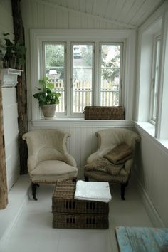 Love this little room, maybe a porch or entry but it's very welcoming along with the cute chairs and windows!