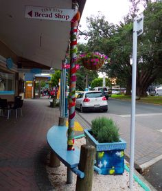 Raglan Town Sign, Decorated Poles, New Zealand