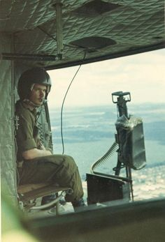 Huey helicopter door gunner ~ Vietnam War this is what my uncle did and was shot down in enemy lines  and survived he was never the same