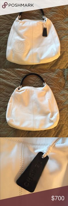"""Chanel late 90's white leatherhandbag/resin handle Excellent like new condition.  This is authentic, but I do not have dust bag or auth. card.  See pic for #.  13 1/2"""" wide at bottom, 12 1/2"""" tall. 3"""" wide at bottom.  Zipper on top(9"""").  Resin handle is black.  There are no stains or scratches. CHANEL Bags Satchels"""