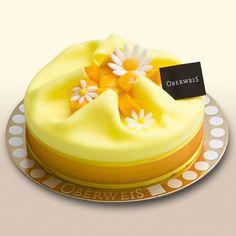 Exotic Prelude. Sponge cake w/ almonds, vanilla cream + passion fruit cream.