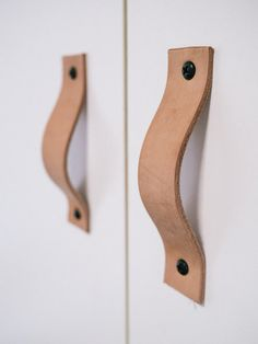 DIY Leather Cabinet Handles-- I would use braided, stamped, and/or dyed leather instead of the plain shown here.
